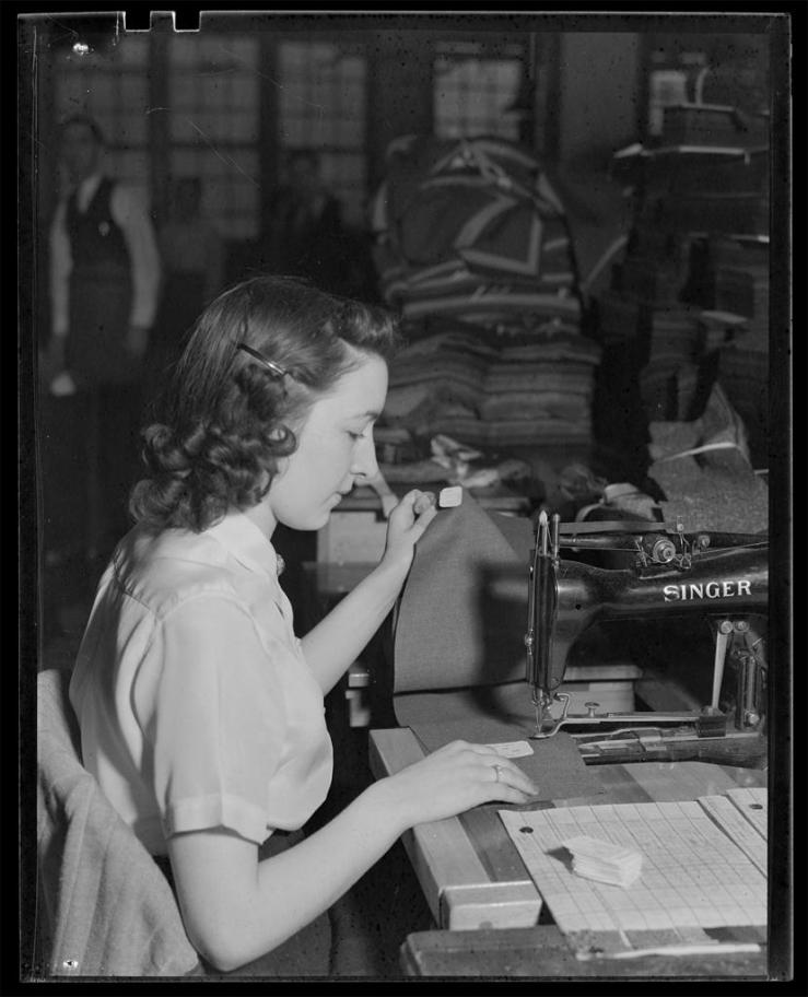 Woman sewing ca. 1930